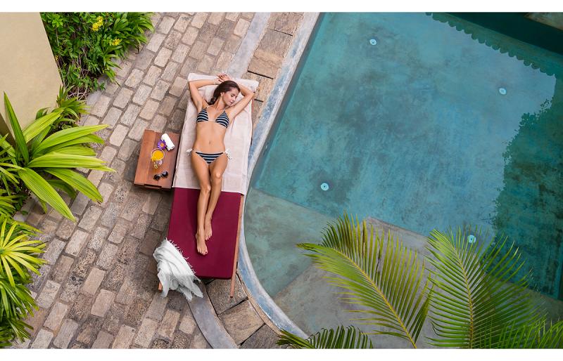 WOman laying by the pool Thambili House Sri lanka
